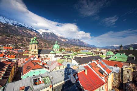 INNSBRUCK, AUSTRIA - March 11, 2017 - People in Innsbruck city center under Stadtturm tower. It is capital city of Tyrol in western Austria, Europe.