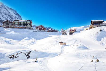 monch: KLEINE SCHEIDEGG, SWITZERLAND - January 2017 - Swiss ski resort with famous Eiger, Monch and Jungfrau peaks in Swiss Alps, Grindelwald, Berner Oberland, Switzerland.