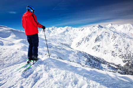 anton: Man enjoying the stunning view before freeride skiing in famous ski resort in Tyrolian Alps, Zillertal, Austria  Stock Photo