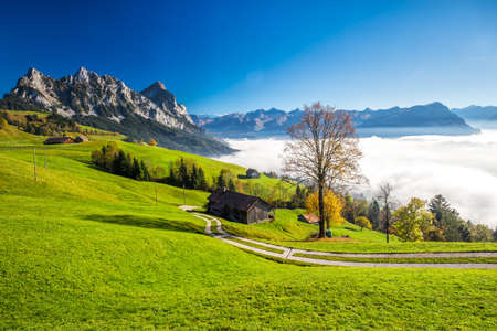 Fog surrounding Grosser, Kleiner Mythen, Lake Lucerne, Rigi mountain and Brunnen city from Sattel, Central Switzerland.