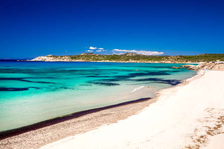 Spiaggia di Rena Majore beach with azure clear water and mountains, Rena Majore, Sardinia, Italy.
