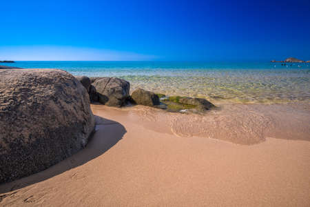 Big stones on Chia beach, Sardinia, Italy, Europe. Sardinia is the second largest island in the Mediterranean Sea Stock Photo