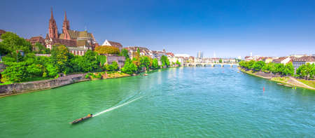 Old city center of Basel with Munster cathedral and the Rhine river, Switzerland, Europe. Basel is a city in northwestern Switzerland on the river Rhine and third-most-populous city. Stock Photo