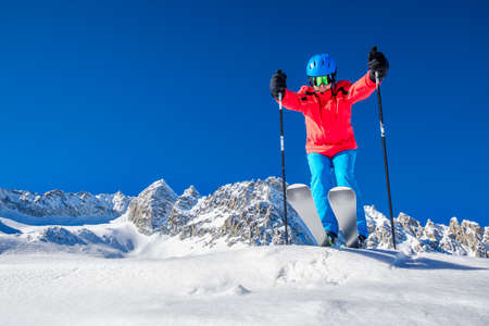 Young happy skier ready for skiing on the top of  Alps. 写真素材