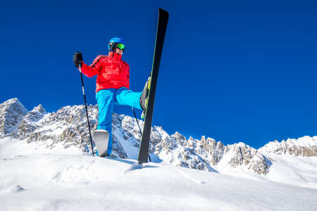 Young happy skier ready for skiing on the top of Alps. Stock Photo