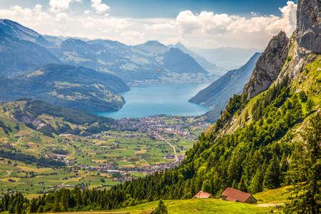 Beautiful summer landscape of Switzerland with Grosser Mythen mountain, Swiss Alps, Vierwaldstattersee and Brunnen town from Ibergeregg, Switzerland, Europe.