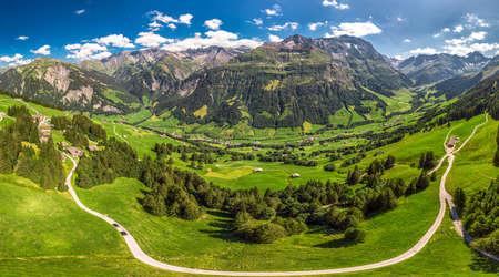 Aerial view of Elm village and Swiss mountains - Piz Segnas, Piz Sardona, Laaxer Stockli from Ampachli, Glarus, Switzerland, Europe.