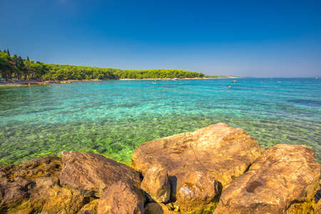 Beach in Supetar town on Brac island with turquoise clear water, Supetar, Brac, Croatia, Europe.
