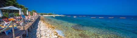 BRAC, CROATIA - August 6, 2018 - Stone beach on Brac island with turquoise clear ocean water, Supetar, Brac, Croatia