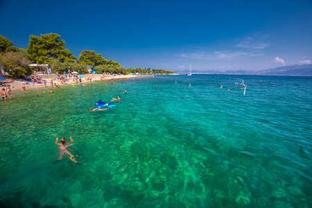 BRAC, CROATIA - August 6, 2018 - Pebble beach on Brac island with turquoise clear ocean water, Supetar, Brac, Croatia
