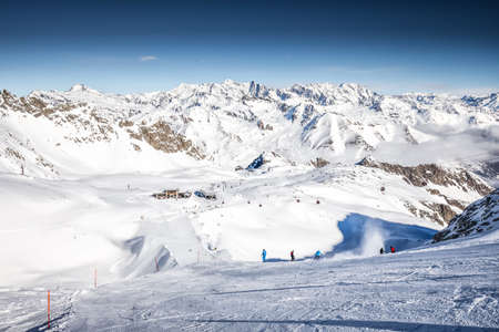 Skiers skiing on the top of Presena Glacier, Tonale, Italy.