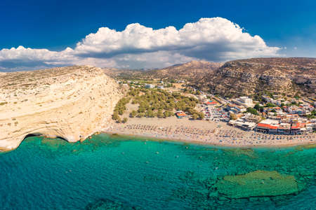 Aerial view of Matala beach on Crete island with azure clear water, Greece, Europe. Crete is the largest and most populous of the Greek islands. Reklamní fotografie