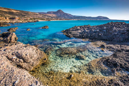 Falassarna beach on Crete island with azure clear water, Greece, Europe. 免版税图像 - 116194696