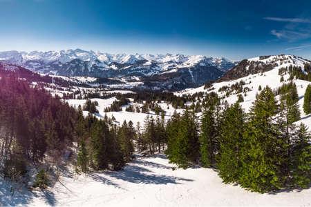Beautiful winter landscape. People skiing in Mythenregion ski resort, Ibergeregg, Switzerland, Europe.