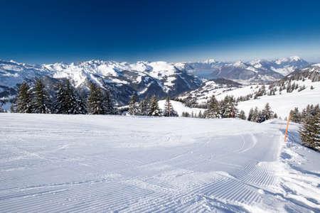 Beautiful winter landscape. People skiing in Hoch Ybrig ski resort, Switzerland, Europe