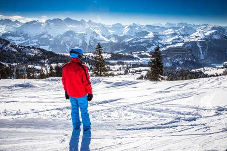 Beautiful winter landscape. People skiing in Mythenregion ski resort, Ibergeregg, Switzerland, Europe