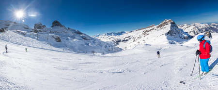 Beautiful winter landscape with Swiss Alps. Skiers skiing in famous Engelgerg - Titlis ski resort, Switzerland, Europe.