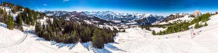 Beautiful winter landscape. People skiing in Mythenregion ski resort, Ibergeregg, Switzerland, Europe. Stock Photo - 121475961