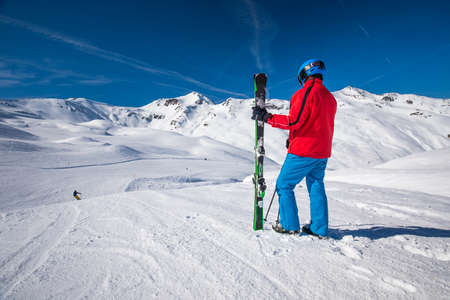 Skier posing in famous ski resort in Alps, Livigno, Italy, Europe.