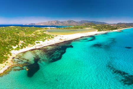 Porto Giunco beach, Villasimius, Sardinia, Italy. Sardinia is the second largest island in the Mediterranean Sea. Imagens - 128516949