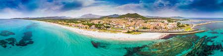 Graniro beach with azure clear water and La Caletta town, Sardinia, Italy, Europe.