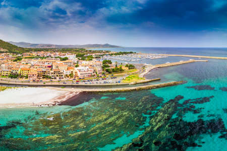 Graniro beach with azure clear water and La Caletta town, Sardinia, Italy, Europe. Stock Photo