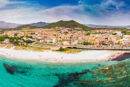 Graniro beach with azure clear water and La Caletta town, Sardinia, Italy, Europe. Stock Photo