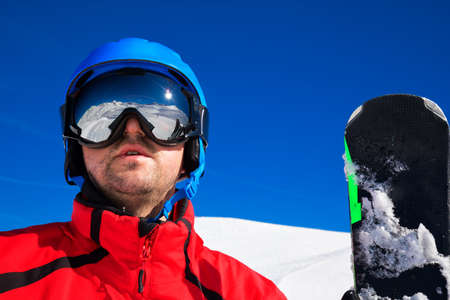 Skieir with ski goggles and its reflection of Alps mountains