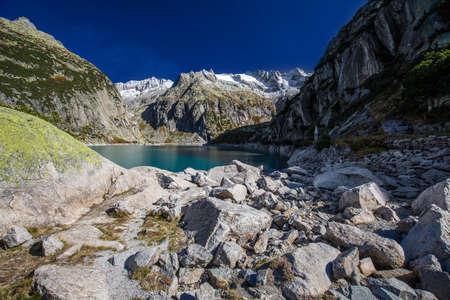 Gelmer Lake near by the Grimselpass in Swiss Alps, Gelmersee, Switzerland, Bernese Oberland, Switzerland. 版權商用圖片