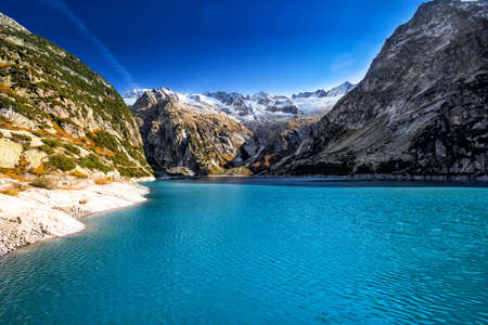 Gelmer Lake near by the Grimselpass in Swiss Alps, Gelmersee, Switzerland. Фото со стока