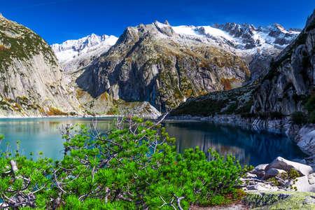 Gelmer Lake near by the Grimselpass in Swiss Alps, Gelmersee, Switzerland, Bernese Oberland, Switzerland. Фото со стока - 136612332