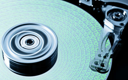 hard disk drive in motion with green data photo