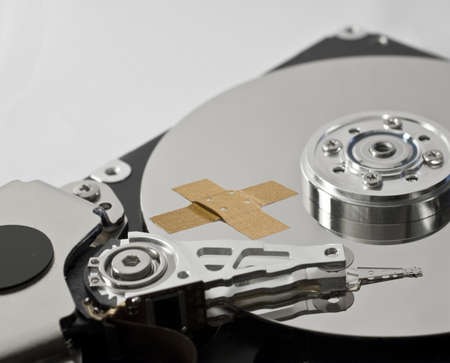 hard disk drive with band-aid in close-up Stock Photo - 10019671