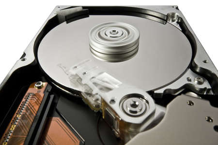 rotating hard disk on white in extreme perspective with moving read write head photo