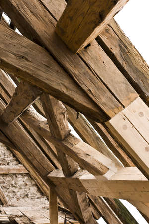 roof framework: wooden framework on ancient roof with old and new wood