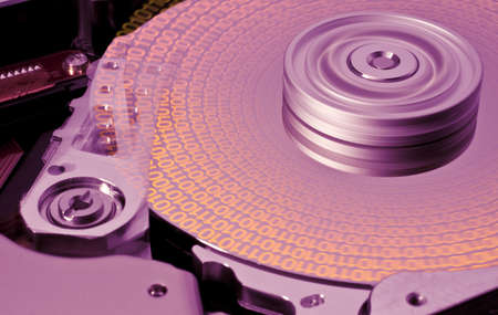 hard disk in motion with binary data. Nice rotation blur on platter. photo