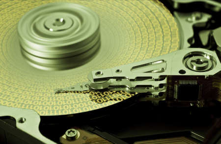 open hard disk drive with yellow data in close up Stock Photo - 10019662