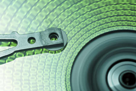 moving hard drive head with green data on drive Stock Photo - 10019663