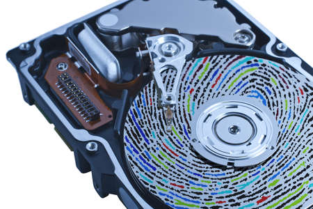 hard disk drive with colored fingerprint on platter in white background. The picture is showing a high performance server disk in close up. This can be used as a symbol for individual data Stock Photo - 10079356