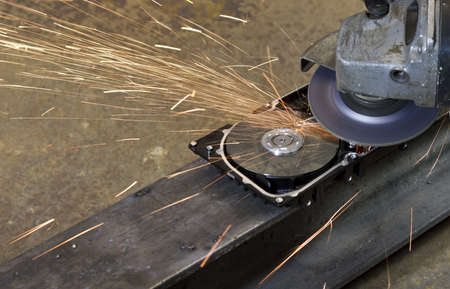 right angle grinder and hard drive Stock Photo - 10079354