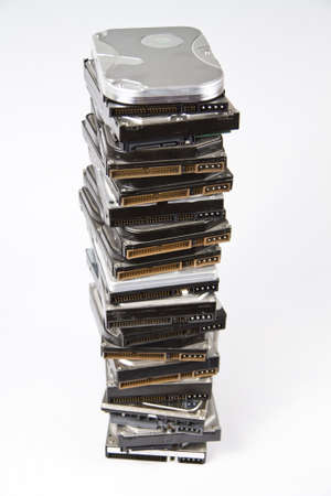 Stack of many different hard drives with opened drives on top. Stock Photo