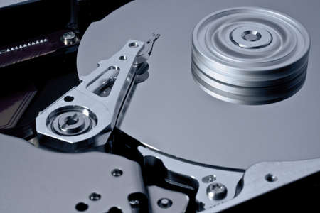 hard disk with rotating platter. read write head without blur Stock Photo