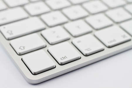 Aluminium keyboard on light background photo