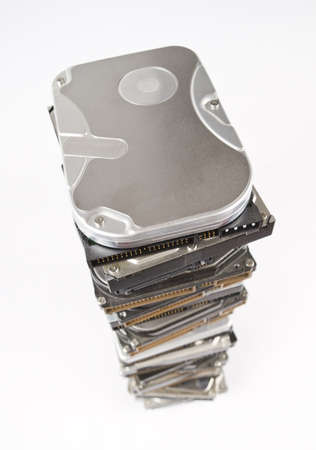 Stack of hard drives with copy space on top in light grey background Stock Photo - 10079315