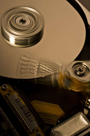 hard disk drive in motion with moving head Stock Photo