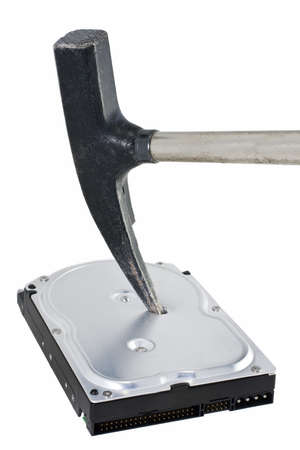 destroyed hard disk drive in white background. Someone used an hammer to erase the data
