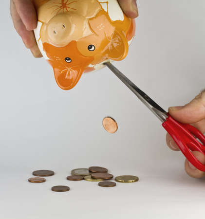 straits: getting money out of piggybank with a cutter. Synonym for financial straits or shortage of money