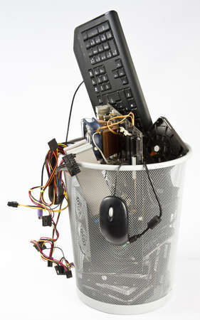 computer parts in trash can. grey background Stock Photo - 10079541