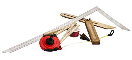 bevel: carpenters tools on white background. measuring tape, bevel, plumb bob, angle bracket, folding rule