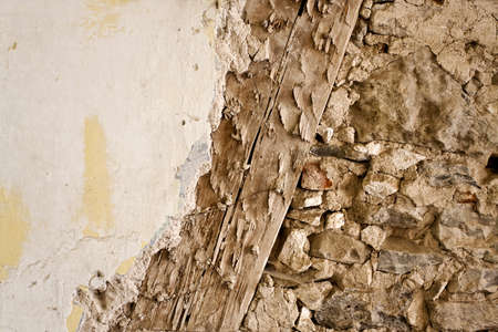 crumbled: Old wall construction with wood, stone and render Stock Photo